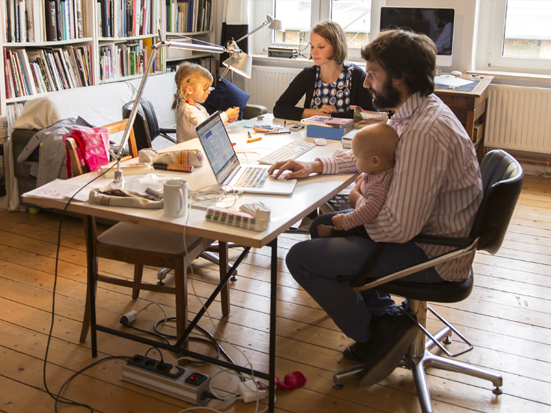 Family working at home at table
