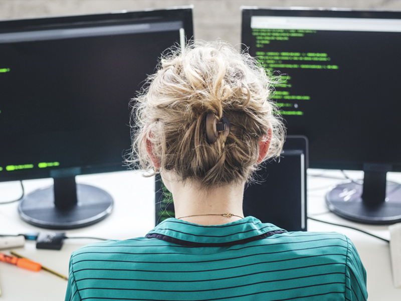 Female employee looking at code