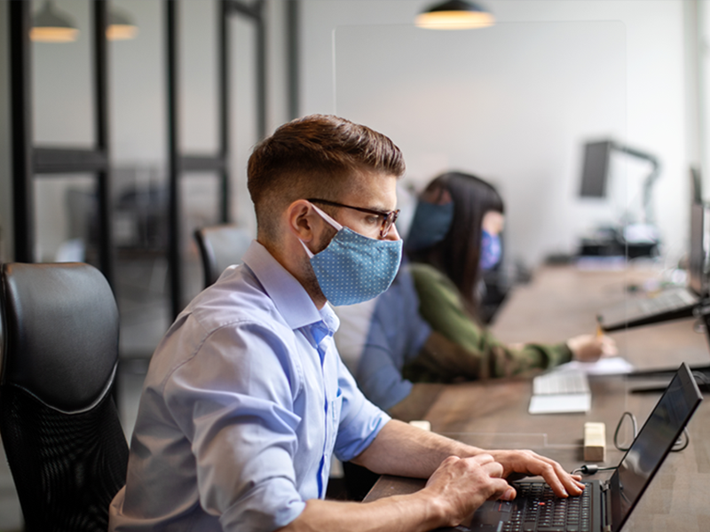 Office employees with masks social distancing